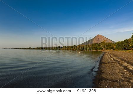 View of a beach at sunset in the Ometepe Island with the Concepcion Volcano on the background in Nicaragua South America