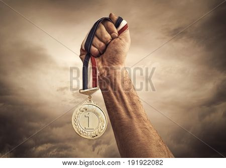 Success concept with medal on clouds background.