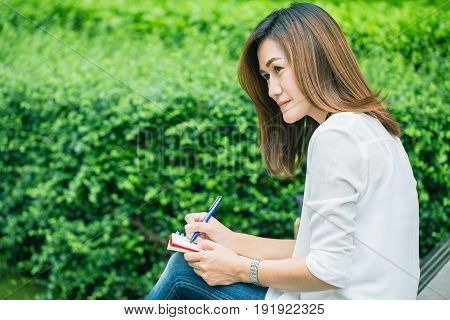 Working Women Writing At Park, Working Outdoor Women Work Business Job Writer Write Text In Notebook