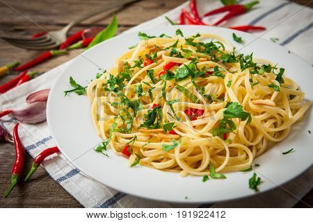 Noodles with garlic and chili on platter with basil decoration