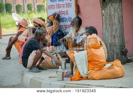 KURUKSHETRA HARYANA INDIA : 19 JUNE 2016 - Indian sadhus (holy man) sitting and chatting