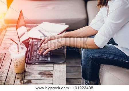 Asian Business Woman Work Typing On Laptop At Coffee Cafe Workplace, Holiday Working Startup Concept