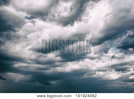 Blue sky with white and black clouds