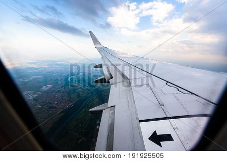 Looking Trough Window Of An Aircraft, Airplane Or Plane Wing.
