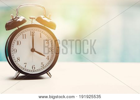 4 o'clock retro clock at the swimming pool outdoor relax time holiday time concept.