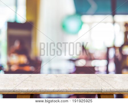 Empty White Marble Table And Blurred Cafe Bokeh Light Background. Mock Up For Display Or Montage Of