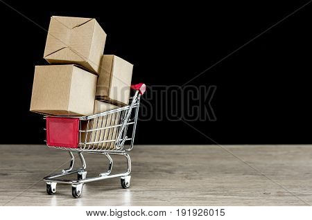 Close up shot of four carton packages in shopping trolley