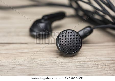 Close up shot of vintage earbuds headphones