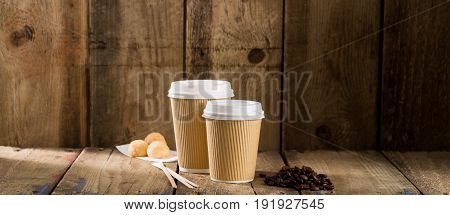 Ribbed Paper Cups Alongside Coffee Beans And Pastry