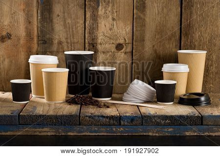Paper Cups On Wooden Shelving