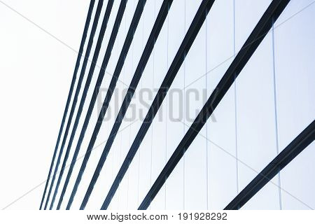 Big modern glass minimalistic office building or factory with straight lines