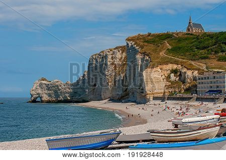 Limestone cliffs of Etretat with its natural arches and beautiful shape over the Atlantic waves.