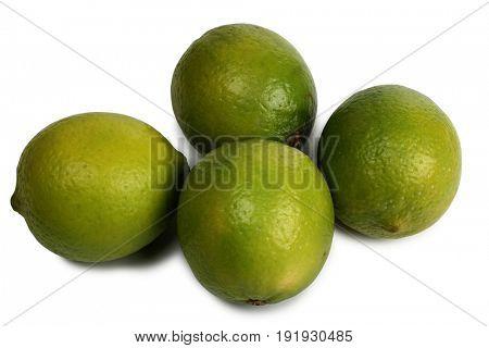 Green lemon fruits on a white background