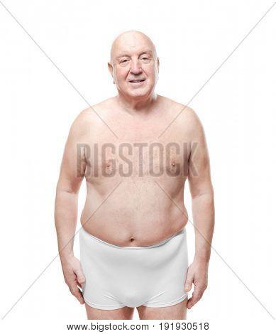 Fat senior man in underwear on white background. Weight loss concept