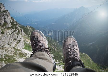 Hiking Boots Over A Mountain Valley