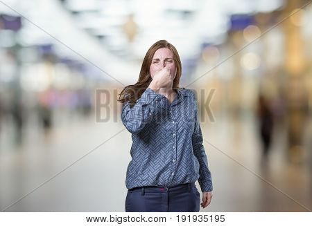 Pretty Business Woman Doing Cover Her Noise Gesture Over Blur Background