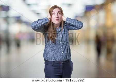 Pretty Business Woman Covering Her Ears Over Blur Background