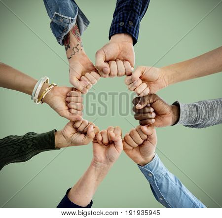 Group of people fist bump assemble together