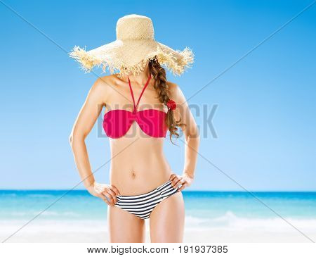 Healthy Woman On Beach Hide Behind Straw Hat