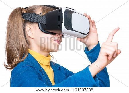 Happy amazed little girl wearing virtual reality goggles watching movies or playing video games, isolated on white background. Cheerful surprised child looking in VR glasses and gesturing