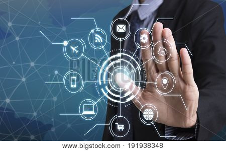 Business hand with application icons interface and networking system. concept technology social network communication.