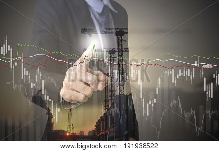 business hand point Trading Stock Graph Chart industry construction. invesment analysis concept.