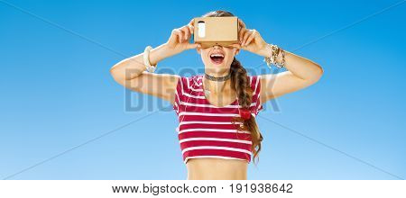 Smiling Active Woman On Seacoast Wearing Vr Gear