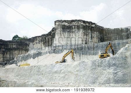 The exploitation of limestone hills forming a unique architectural in Jeddih or Jaddih Hill Madura Island, Indonesia
