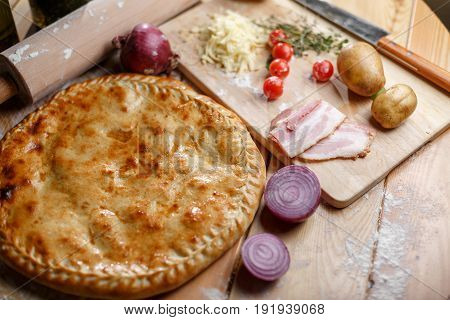 Baked pizza with salmon and feta and ingredients. Italian traditional food. Top View. ingredients for cooking on the table