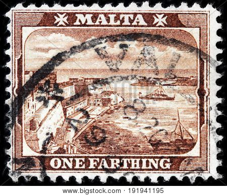 LUGA RUSSIA - APRIL 26 2017: A stamp printed by MALTA shows view of Grand Harbor Valetta circa 1910