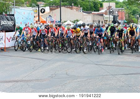 STILLWATER, MINNESOTA/USA - JUNE 18, 2017: Competitors line up for the start of the men's Pro/Elite Stillwater Criterium bike race, the final race of the six stage North Star Grand Prix.
