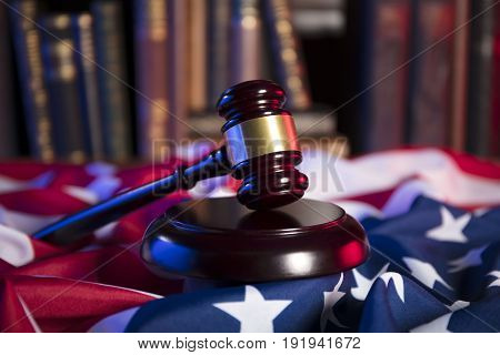Independence Day theme. 4th of July. American Declaration of Independence. Gavel, library, different codes and american flag. Red and blue. Place for typography.