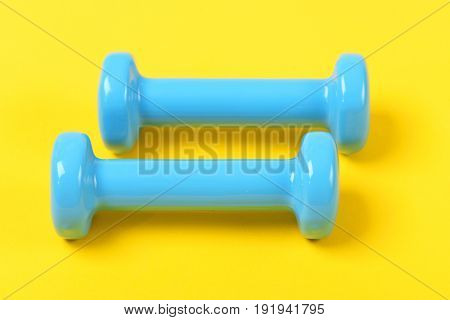 Workout And Exercise Equipment: Two Dumbbells In Light Blue Color