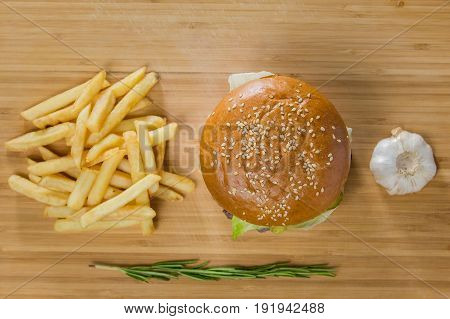 Fresh appetizing burgers with potatoes, top view