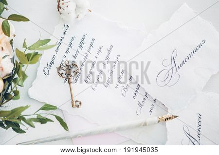Invitations to the wedding, key and flowers