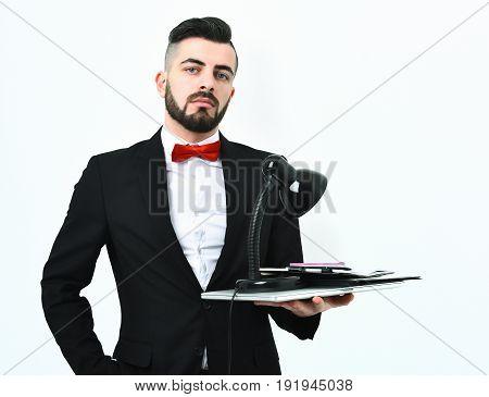 Stylish Corporate Businessman Holding Desk Lamp, Folders And Laptop