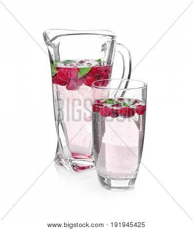Tasty refreshing lemonade with berries on white background
