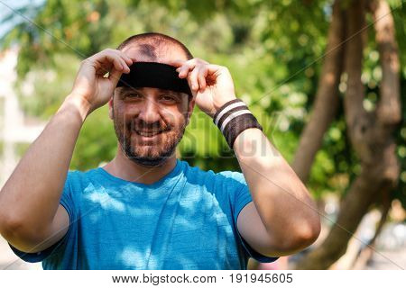Man Wearing A Head Band In A Park