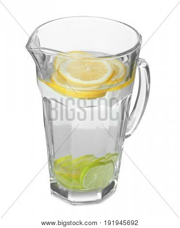 Tasty refreshing lemonade with lime in glass jug on white background