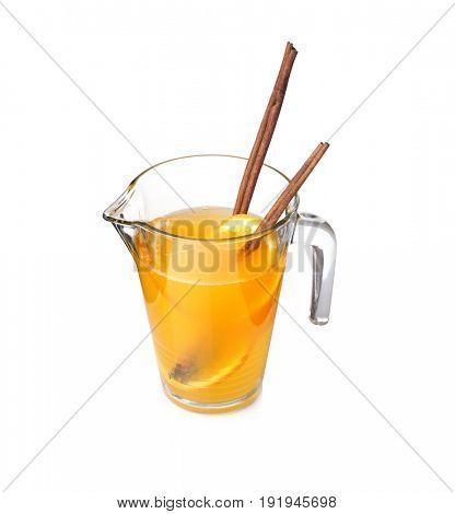 Tasty refreshing lemonade with orange in glass jug on white background