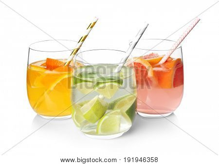 Tasty refreshing lemonade with different fruits in glasses on white background