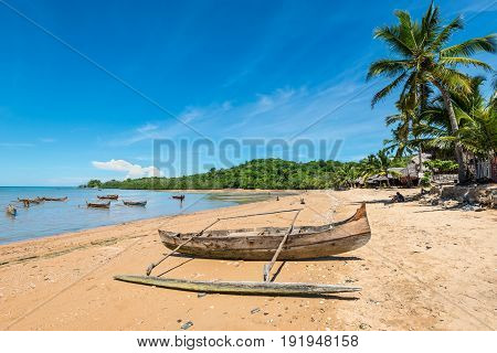 Ampasipohy Nosy Be Madagascar - December 19 2015: Traditional pirogue on the shore of Nosy Be island in Madagascar Africa.