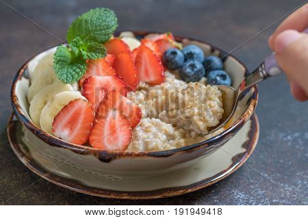 Bowl of delicious irish steel cut oats with fresh fruit, honey