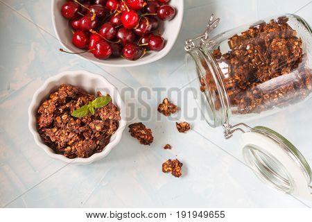 Chocolate muesli (granola) in a glass jar.