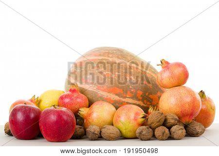 Autumn fruits on a white background