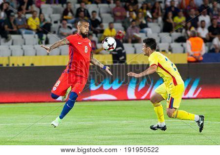 CLUJ-NAPOCA, ROMANIA - 13 JUNE 2017: Chile's Arturo Vidal (R) in action during the Romania vs Chile friendly, Cluj-Napoca, Romania - 13 June 2017