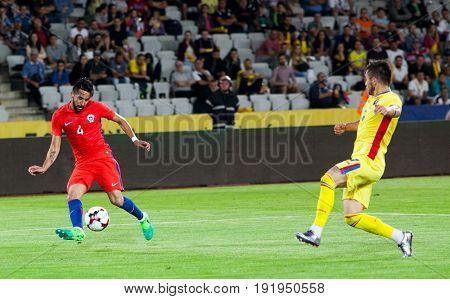 CLUJ-NAPOCA, ROMANIA - 13 JUNE 2017: Chile's Mauritio Isla (L) fights the ball with Romania's Alin Tosca during the Romania vs Chile friendly, Cluj-Napoca, Romania - 13 June 2017