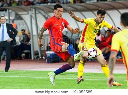 CLUJ-NAPOCA, ROMANIA - 13 JUNE 2017: Enzo Roco (L) of Chile fights the ball with Andrei Ivan of Romania during the Romania vs Chile friendly, Cluj-Napoca, Romania - 13 June 2017