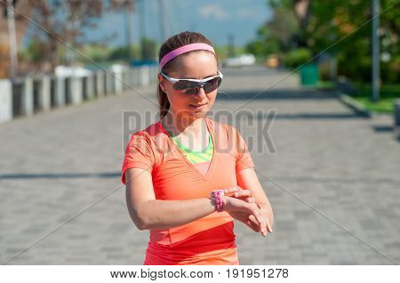 Sportswoman Checks The Result On A Smartwatch