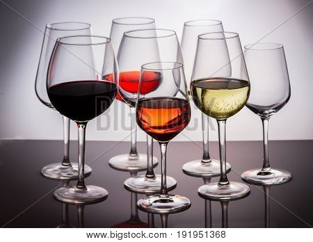 Set of glasses with red, white and rose wine